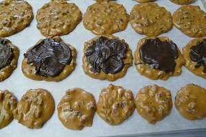 New batch of hand dipped pralines. Minis are a little of one half to size of the Original.